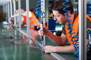 Men during precision work on production line, horizontal.jpeg